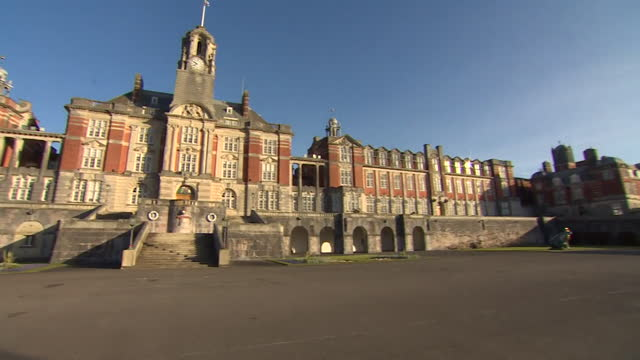 """exterior of britannia royal naval college in dartmouth, where prince philip first met the queen - """"bbc news"""" stock videos & royalty-free footage"""