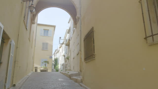 WS PAN Exterior of building and cobblestone street in Old Town / Antibes, France