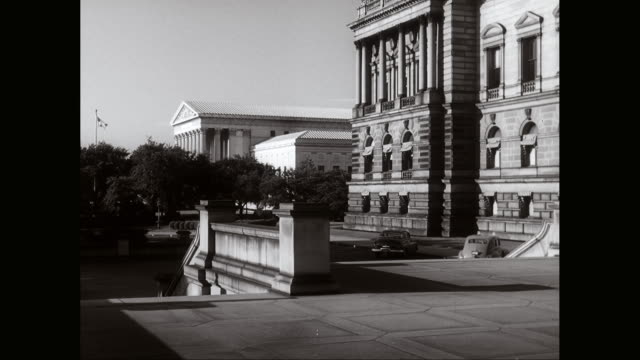 WS Exterior of building, courthouse in background / Washington DC, United States