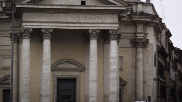 Exterior of buildings and streets in the Piazza del Popolo.