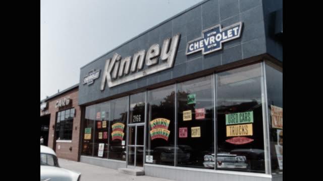 exterior of car showroom against sky - car showroom stock videos & royalty-free footage