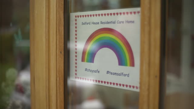 exterior of care home in warwickshire, closed to visitors during coronavirus pandemic, but preparing to reopen its doors to so loved ones can visit... - rainbow stock videos & royalty-free footage