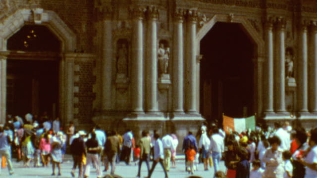 exterior of cathedral / clock and corner stone / basilica of our lady of guadalupe on april 20 1971 in mexico city mexico - バシリカ点の映像素材/bロール