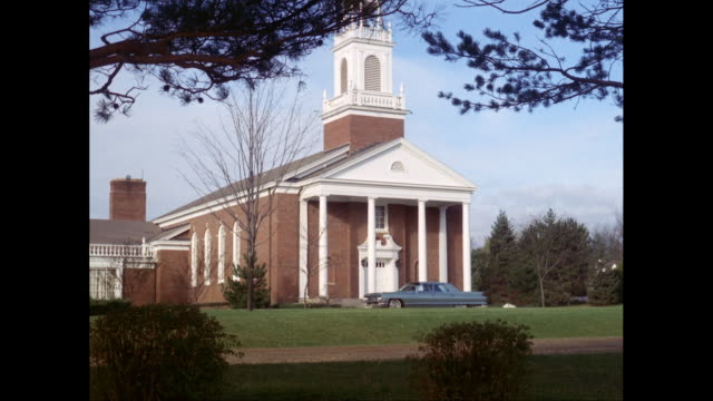 WS Exterior of church with car parked in foreground / United States