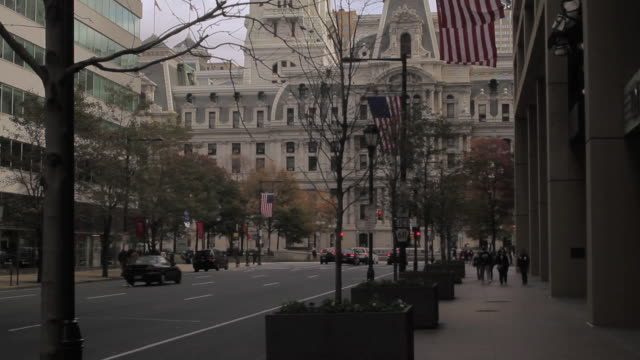 tu exterior of city hall building and surrounding area adorned with american flags / providence, rhode island, united states - william penn stock videos and b-roll footage