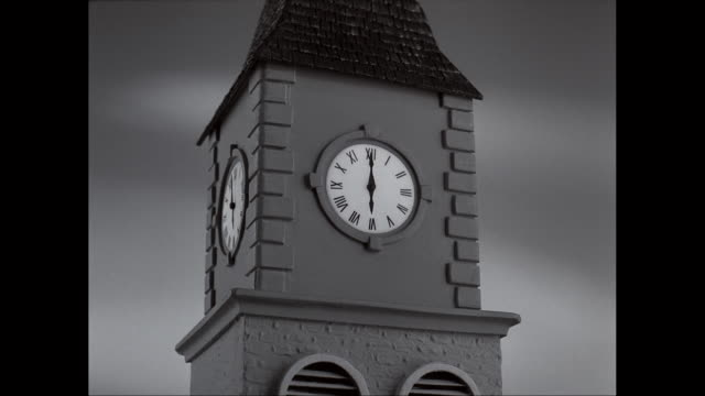 ms exterior of clock tower with clock face against clear sky / united states - roman numeral stock videos & royalty-free footage