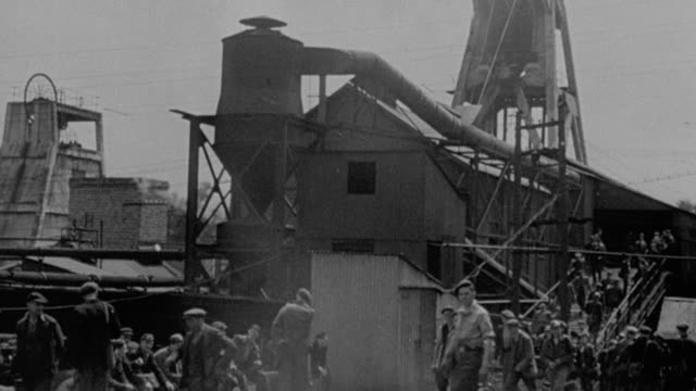 1978 MONTAGE Exterior of colliery / inside a shaft as equipment is being lowered / coal miners walking around a plant / United Kingdom