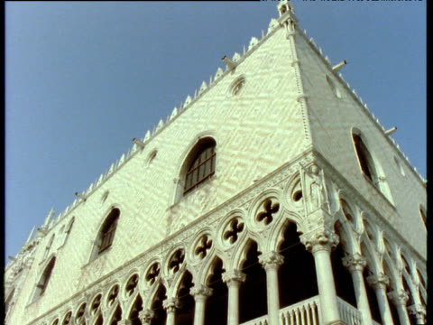 stockvideo's en b-roll-footage met exterior of doge's palace focusing on the windows and ornate columns along veranda venice - 1992