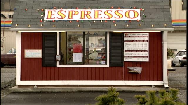 exterior of drive thru espresso shop and signs in snohomish, washington - hinweisschild stock-videos und b-roll-filmmaterial