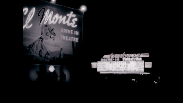 ms exterior of drive-in theatre at night / united states - theater marquee commercial sign stock videos & royalty-free footage