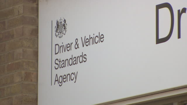 """exterior of driver and vehicle standards agency as learner drivers are experiencing difficulty in booking drivers tests due to backlog caused by... - """"bbc news"""" stock videos & royalty-free footage"""