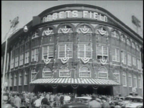 exterior of ebbets field with crowd arriving for the game / fans in the bleachers - ebbets field video stock e b–roll