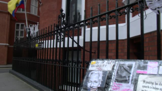 Exterior of Ecuador Embassy where Julian Assange was held with board supporting his cause outside on the pavement London