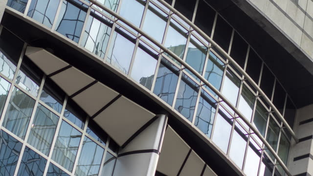 exterior of european parliament debating chamber - timelapse - curtain wall facade stock videos and b-roll footage
