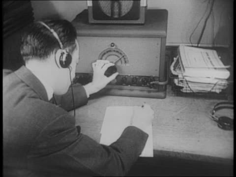 exterior of fbi listening post / montage of men typing, listening to communications with headsets, recording foreign language broadcasts, mapping an... - fbi video stock e b–roll