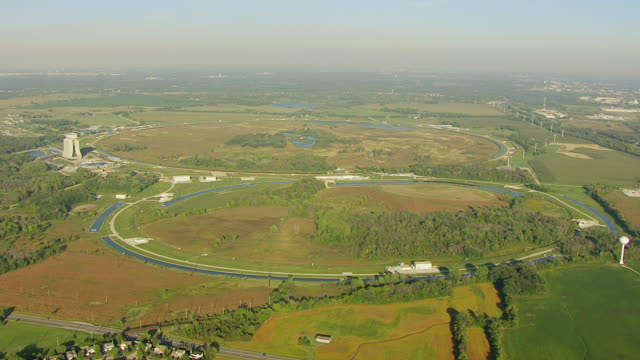 ws aerial pov exterior of fermi national accelerator laboratory in city / batavia, dupage county, illinois, united states - dupage county stock videos & royalty-free footage