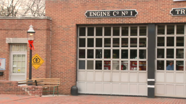 WS PAN Exterior of fire station as fire fighters sit inside talking/ Richmond, Virginia