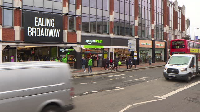 exterior of first amazon fresh supermarket in uk, where you don't have to scan products or go to a checkout, in ealing broadway - 出来事の発生点の映像素材/bロール