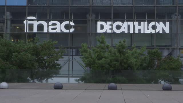 """vidéos et rushes de exterior of fnac decathlon in la defense business district in paris - """"bbc news"""""""