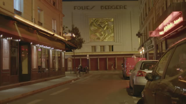 WS TD Exterior of Folies Bergere at night / Paris, France