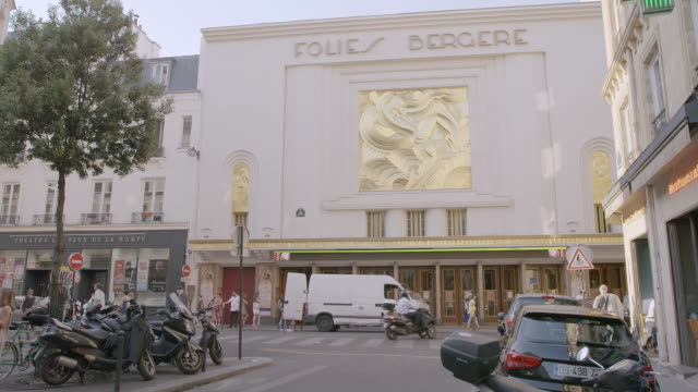 WS Exterior of Folies Bergere Building, vehicles parked in foreground / Paris, France