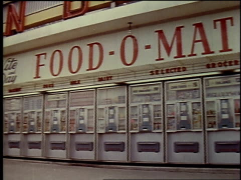 1957 montage exterior of food-o mat and someone inserting coins and getting food out of vending machine inside / brussels, belgium - 1957 stock videos & royalty-free footage