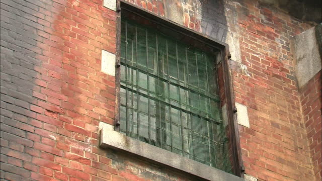 Exterior of Former Army Clothing Depot in Hiroshima Metal barred window on the façade
