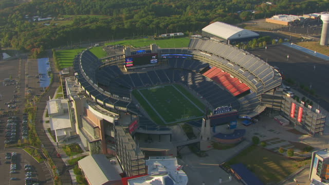 WS AERIAL POV Exterior of Gillette Stadium / Foxborough, Massachusetts, United States