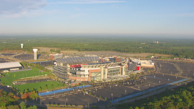 WS AERIAL POV Exterior of Gillette Stadium with landscape / Foxborough, Massachusetts, United States