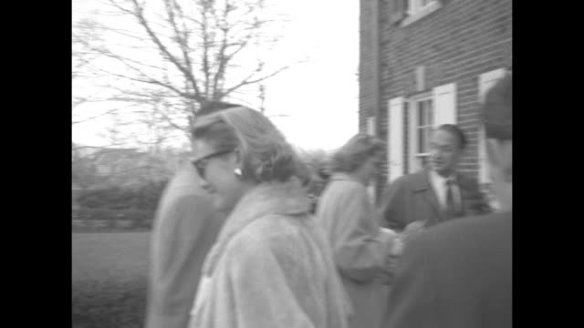 ws exterior of grace kelly house in philadelphia press in driveway / kelly with sunglasses and fur on walks with others toward door of house prince... - monaco royalty stock videos and b-roll footage
