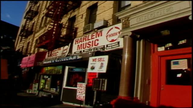exterior of harlem music store and side walk - ミュージックショップ点の映像素材/bロール