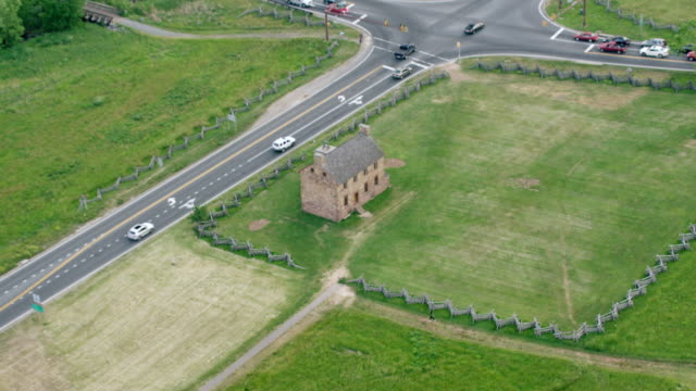 ws zo aerial pov exterior of henry house and cars moving on road at manassas national battlefield park / manassas, virginia, united states - battlefield stock videos & royalty-free footage