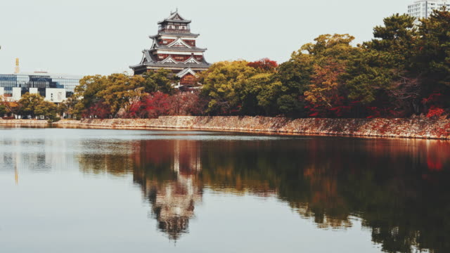 exterior of hiroshima castle pond reflections japan - japan stock videos & royalty-free footage