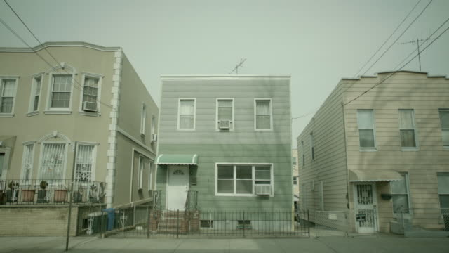 ws exterior of homes in queens / new york city, new york - letterbox stock-videos und b-roll-filmmaterial