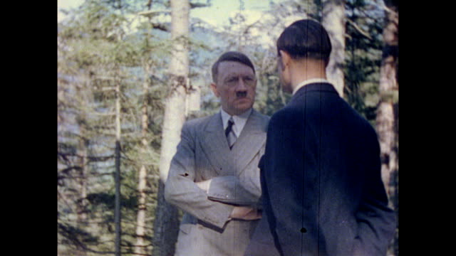 exterior of house / man plowing field, horses pulling plow / mountain views / wooded path / adolf hitler, arms crossed, speaking with man / group on... - adolf hitler stock videos & royalty-free footage