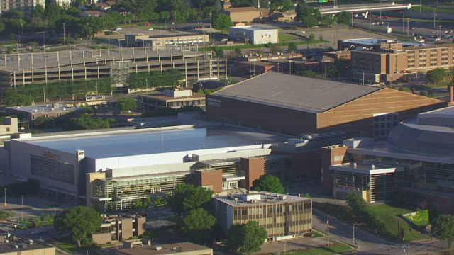 WS AERIAL POV Exterior of Hy-Vee Hall in city / Des Moines, Iowa, United States