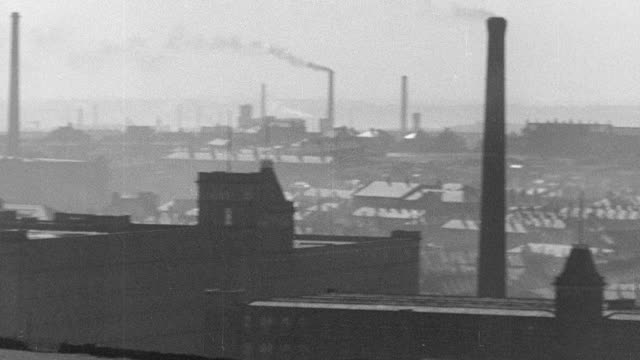 pan exterior of industrial mills in operation, paper clippings announcing the closing of spinning mills, workman closing the gates at a mill and exterior of mill with a sign displaying its sale / united kingdom - closed stock videos & royalty-free footage