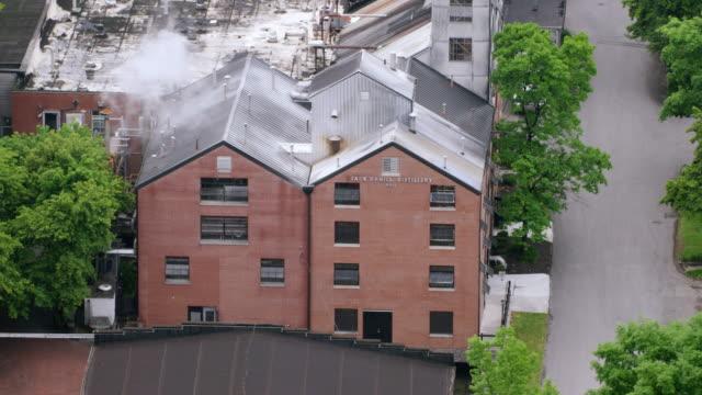 WS AERIAL POV Exterior of Jack Daniel's Distillery / Lynchburg, Tennessee, United States