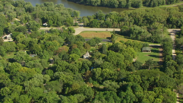 ws aerial pov zi exterior of john deere house and shop with trees / grand detour, lee county, illinois, united states - zoom in stock videos & royalty-free footage