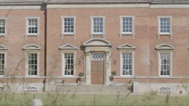 MS R/F Exterior of Kelmarsh Hall with garden / Northamptonshire, England, United Kingdom