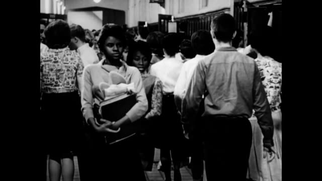 exterior of little rock central / students of mixed races walking down school hallways / elizabeth eckford walking down hallway. - separation stock videos & royalty-free footage