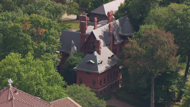 ws aerial pov exterior of mark twain house hidden in trees / hartford, connecticut, united states - mark twain stock videos & royalty-free footage