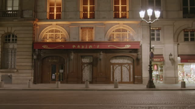 MS Exterior of Maxim's de Paris restaurant at night / Paris, France