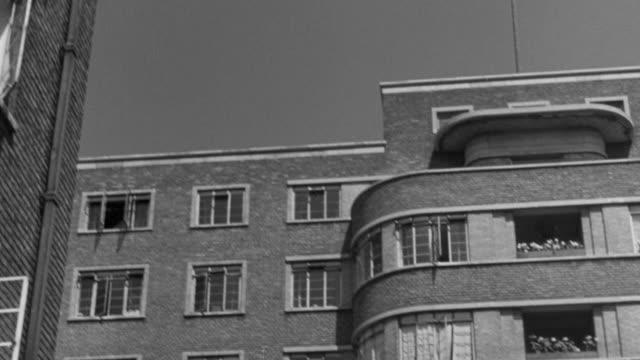 1946 tu exterior of modern brick apartment building / united kingdom - れんが造りの家点の映像素材/bロール