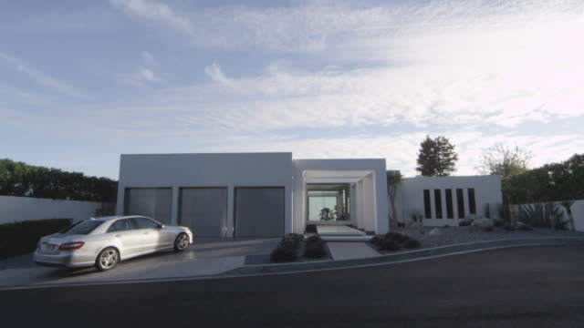 WS Exterior of modern house with car parked in driveway