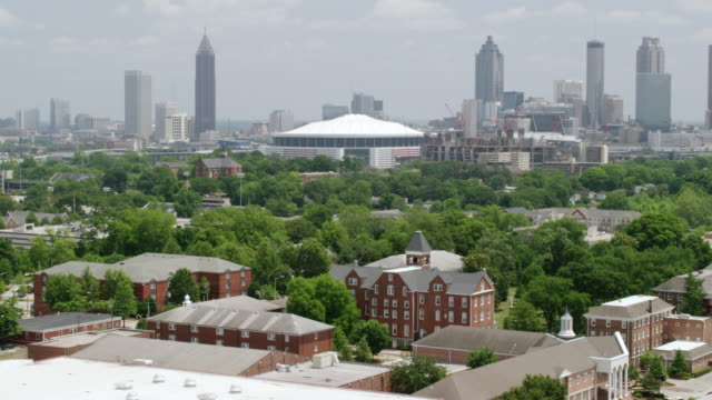 WS ZO AERIAL POV Exterior of Morehouse College and Grave Hall, city skyline in background / Atlanta, Georgia, United States