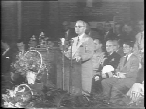 stockvideo's en b-roll-footage met exterior of municipal auditorium independence missouri / a large crowd stands outside an auditorium / interior of auditorium crowds flags draped on... - margaret truman