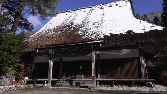exterior of myozenji temple closeup shot of the kayabukistyle thatched roof with the shot panning to the right myozenji temple which is constructed... - honshu stock videos and b-roll footage