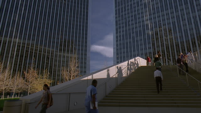 ws pan exterior of office block building and people walking on steps / century city, california, usa - century city stock videos & royalty-free footage