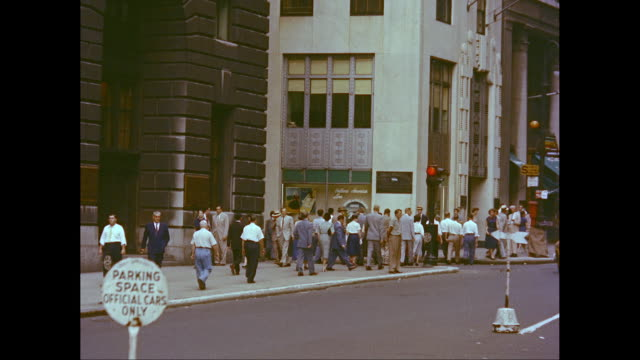 ms exterior of office block, people walking on sidewalk / broadway, lower manhattan, new york city, new york state, united states - anno 1950 video stock e b–roll